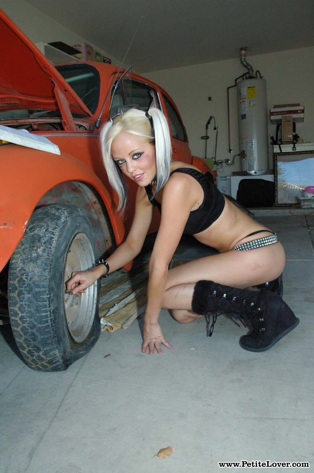 lindsay marie   sexy petite blonde gets dirty working on a car
