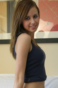Petite Natalie Posing On The Couch - Picture 5